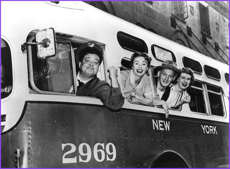 The cast of The Honeymooners in a publicity photo: Jackie Gleason as Ralph Kramden, Audrey Meadows as Alice Kramden, Carney as Ed Norton and Joyce Randolph as Trixie Norton