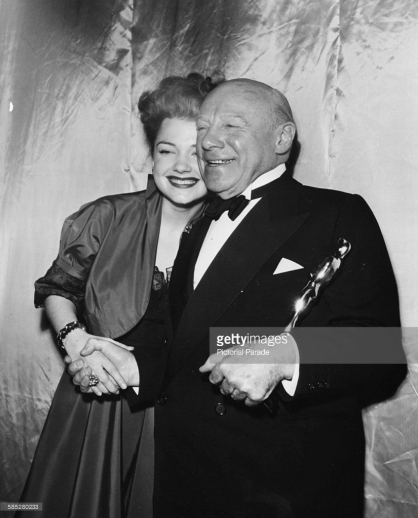 With presenter Anne Baxter at the Academy Awards