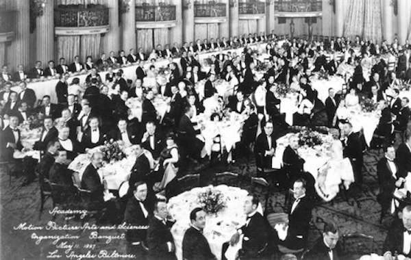 11th May 1927: Interior view of formally dressed men and women seated at tables during the first organizational meeting of the Academy of Motion Picture Arts and Sciences in the Crystal Ballroom of the Los Angeles Biltmore Hotel. Mary Pickford, Douglas Fairbanks, Louis B. Mayer, Jack L. Warner and Darryl F. Zanuck attended the banquet. (Photo by Hulton Archive/Getty Images)