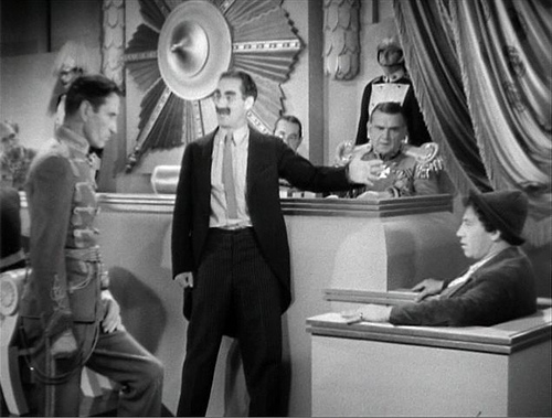 A judge presides over Chicolini's trial in Duck Soup
