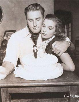 Errol Flynn and Lili Damita with their wedding cake.