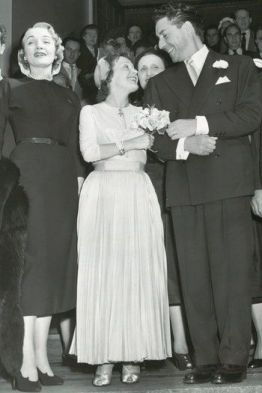 Marlene Dietrich is matron of honor at the wedding of Édith Piaf and Jacques Pills