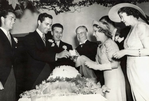 Mary Pickford and Buddy Rogers Cutting Wedding Cake