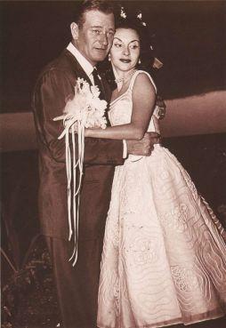 ohn Wayne and third wife Pilar Palette