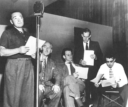 Lorre broadcasts live with the Mystery In The Air crew. The other man standing is Harry Morgan.
