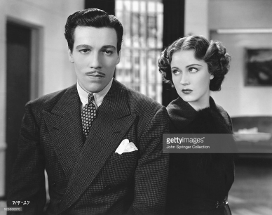 Cesar Romero and Fay Wray in CHEATING CHEATERS (1934)