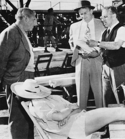 Kate Hepburn snoozes on set of Pat and Mike dir George Cukor goes over a scene with Spencer Tracy and Aldo Ray