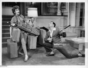 Kay Kendall and Gene Kelly enjoying golf shenanigans in LES GIRLS