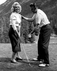Marilyn Monroe learning to play golf