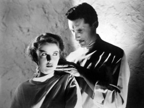 Martha Vickers and John Carradine in Captive Wild Woman