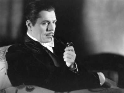 Warner Baxter epitomizes the look with pipe