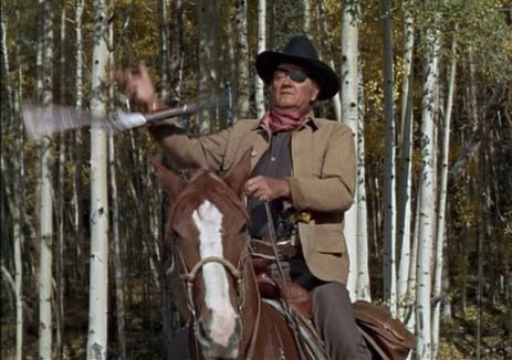 John Wayne as Rooster Cogburn in TRUE GRIT 1969