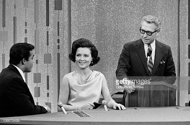 Betty White and Allan Ludden with a contestant on Password in 1967