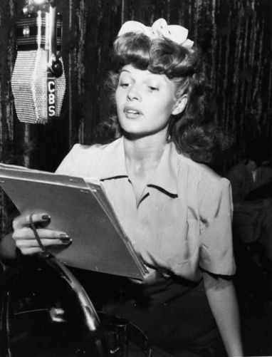 Rita Hayworth taping a radio show