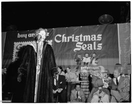 Barbara Britton talks to the crowd at a fundraising event in 1953