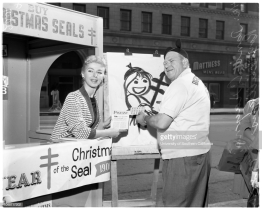 Christmas seal booth at Hollywood Boulevard and Vine Street, 8 December 1956. Dani Crayne (starlet) and Roy Williams