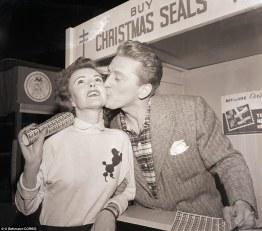 Kirk Douglas kisses a fan for Christmas Seals in 1949