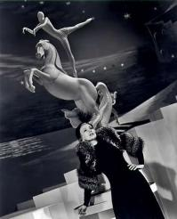 Ann Sothern and circus acrobat on horse statue – 1939